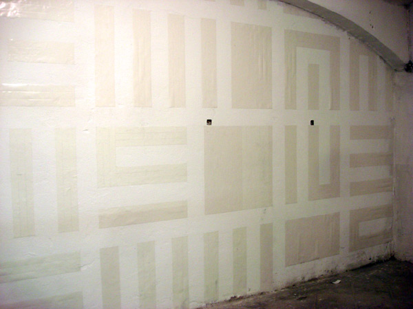 ...with double face tape on a big wall on one of the room of the gallery...
